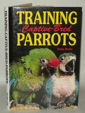 Training Captive Bred Parrots - Delia Berlin - HB - Illustrated.