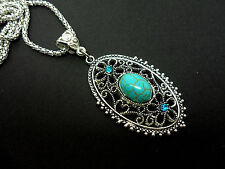 A LOVELY OVAL TURQUOISE PENDANT NECKLACE.  NEW.