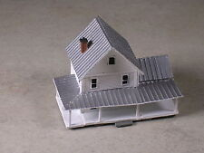 Z Scale White Farm House with many porches.
