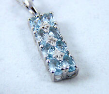 STERLING SILVER PENDANT WITH EIGHT BLUE TOPAZ GEMSTONES AND ONE DIAMOND