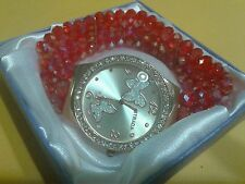 """RED TRIPLE STRAND CRYSTAL LARGE FACE WATCH W/BUTTERFLIES IN FACE- 7 1/2 """" TO 10"""""""