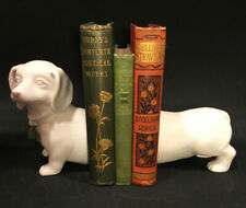 Dachshund book ends. Doggie bookends. White with silvertone dogbone collar tag.