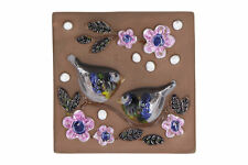 A vintage Swedish pottery bird wall plaque Purple Deco
