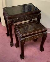Vintage Pair Of Chinese Carved Wood Figural Scene Glass Top Nesting Tables