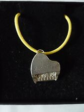 """Piano TG2 English Pewter On 18"""" Yellow Cord Necklace"""