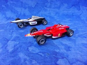 $1-7 Day Pair 1/43 Carrera GO F1 Slot Cars Cars to Racing David Mercedes & Red