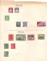 6 old IRELAND + 7 old JAMAICA stamps on an album page.