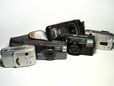 Nikon AD3, Nikon Lite Touch Zoom 70W, Nuvis 75, Nuvis 160i compact film cameras