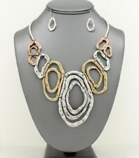 Statement Tri Tone Gold NEW Metal Oval Abstract Hypnosis Style Bib Necklace Set