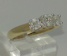 Three-Stone Yellow Gold SI1 Fine Diamond Rings