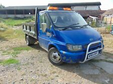 Transit tipper with tale lift