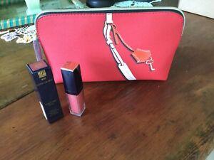 Estée Lauder red makeup bag with pure envy paint on lip colour.rebellious rose.