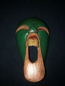 New hand carved green wooden screaming face wall hanging
