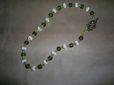 Hand made necklace.  cream white and olive green