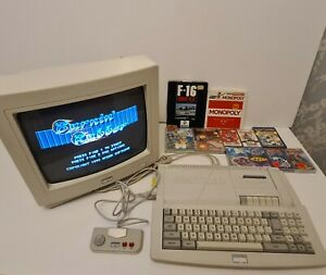 Amstrad (CPC) 464 Plus & CM14 Colour Monitor. Refurbished & tested. Free Games.