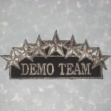 "Demo Team Patch - 4 7/8"" x 2 1/8"" - black & silver"
