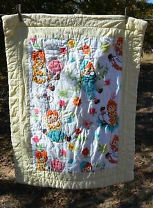 "Raggedy Ann & Andy pale yellow quilted  30x38"" crib quilt"