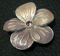 Lovely pendant in silver tone metal in a flower form with pink stone 1ins wide