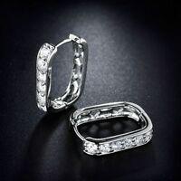 18K White Gold and Diamond Hoop Earrings    243