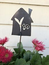 Home with a heart cut metal plant stake lawn outdoor garden art decor