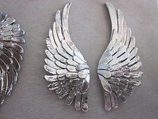 1 pair of Silver wings - Metal. 6 sets available