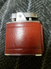 ronson vintage lighter with leather effect cover. Still in box.
