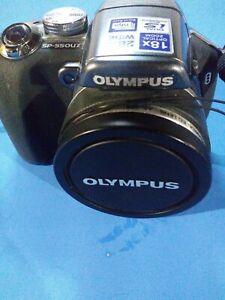 Olympus SP-55OUZ Digital Camera 18x Optical Zoom