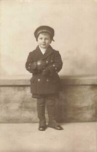 SWEET YOUNG BOY HOLDING A BLACK TOY BALL  HMS IRON DUKE ON HIS HAT 1922 POSTCARD
