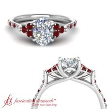 One Carat Oval Shaped Diamond Cathedral Style Engagement Ring With Ruby Gemstone