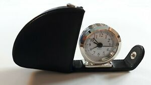 Travelling compact alarm clock, leather case.