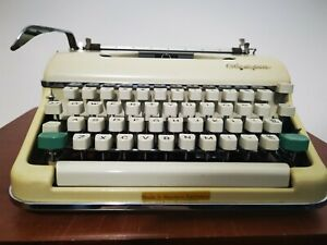 Vintage Portable Olympia Manual Typewriter with Case