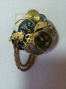 Steampunk brooch made with clock parts and chain. Everything is metal.