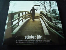 October File - The Application of Loneliness Ignorance Misery, Love and Despair