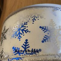 CHRISTMAS WIRE EDGED RIBBON - SILVER/BLUE SNOWFLAKES WITH SPARKLEY SPECKS.
