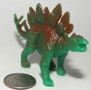 Small Plastic Figure of a Stegosaurus Dinosaur in Green & Brown