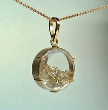 14 kt gold pendant with diamonds inside and 14 kt gold chain