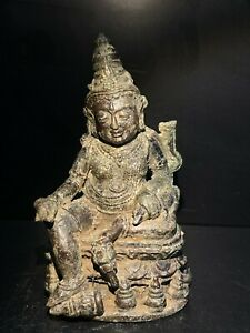 old ancient antique Zambala bronze statue from south east Asia