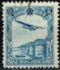 China Manchukuo Aircraft over Railroad Bridge stamp 1936