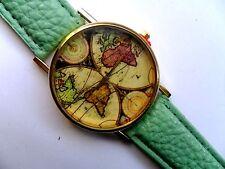 PARTICOLARE MAPPAMONDO ORO CON VISO orologio al quarzo verde cinturino