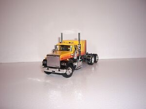 DCP FIRST GEAR 1/64 ORANGE, YELLOW, BLACK MACK SUPER-LINER WITH 60'' FT SLEEPER