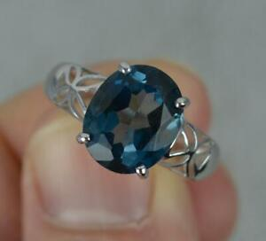 9 Carat White Gold Oval Blue Topaz Solitaire Ring