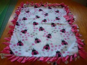Handmade fleece tie blanket of ladybugs for a small pet