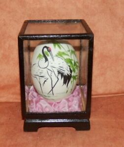 Beautiful collectable egg with oriental stork design in glass/wooden case