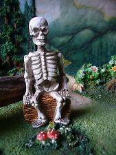 Skeleton sitting on a log  DA 3115-399 Miniature Fairy Garden Dollhouse