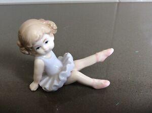 Cute Sitting Porcelain Ballerina In Purple Dress