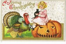 ANTIQUE THANKSGIVING Postcard  YOUNG GIRL SITTING ON PUMPKIN, HOLDING BLACK CAT