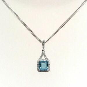 18ct white gold pendant  with Topaz and Diamonds 0.18ct
