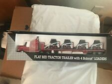 Bobcat Flatbed Tractor Trailer with 4 Bobcat Loaders Diecast model