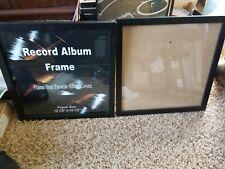 "2 RECORD ALBUM FRAMES.  12 1/2"" X 12 1/2""."