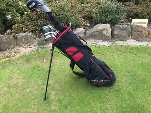 Men's left handed golf clubs, driver, golf bag and buggy